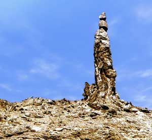 """A salt formation known as """"Lot's Wife as a Pillar of Salt"""", located near the Dead Sea, at Mount Sodom in Israel. The narrative of Lot's wife begins in Genesis 19, after two angels arrive in Sodom and urge Lot to get his family and flee, and not look back. Traveling behind her husband, Lot's wife looked back, thereupon turning into a pillar of salt."""