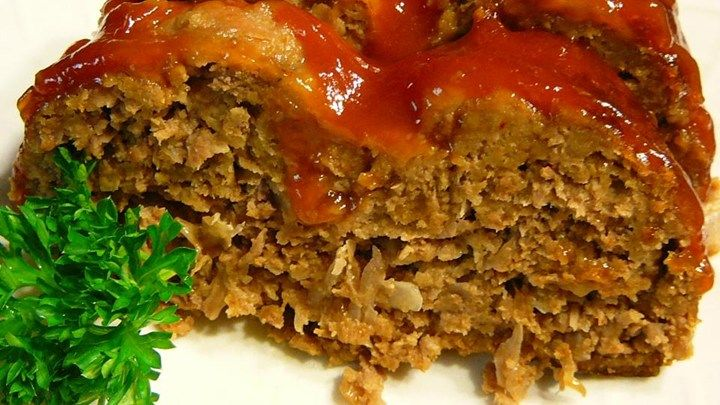 A recipe for Amish meatloaf topped with bacon strips and a ketchup glaze that I had while in Amish country in Holmes County, Ohio.