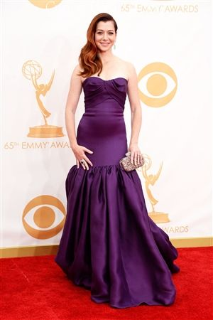 Alyson Hannigan's 2013 Emmy Awards Marchesa Satin Mermaid Gown has a Strapless Neckline, Folded Pleated Bust, Fitted Bodice Past Hips, Gathered Mermaid Skirt, Court Train, Back Hidden Zipper Closure. #alysonhannigan #alysonemmys #custommarchesa #customredcarpetdress #bestdressed #emmys2013 #alysonhannigandress #purplemarchesa #redcarpet