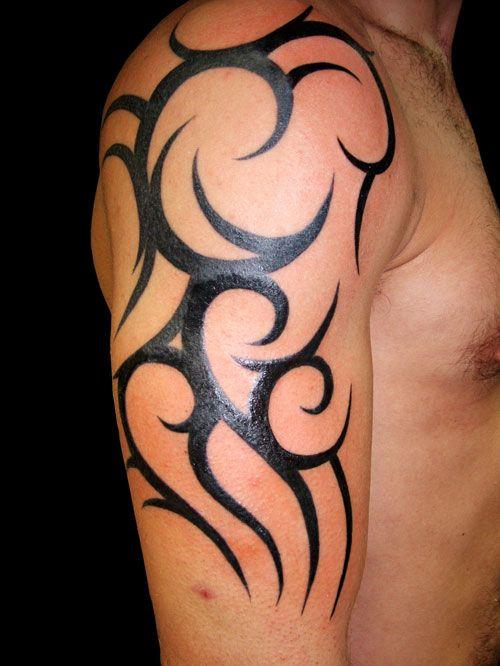 Female tattoo designs | ... Tribal Arm Tattoo Design for Guys 2011 Ancient Tribal tattoos Designs