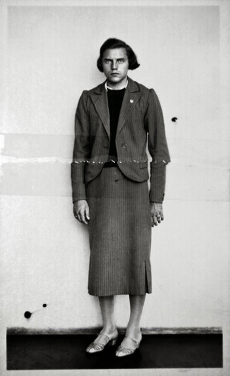 Dora Ratjen, a German Olympic athlete, who was arrested at a train station on suspicion of being a man in a dress, 1938. Born a male but raised as a female, Ratjen competed on the female German track team. She set a world record for the high jump at the 1938 European Athletics Championships, but competed as a female at that event. Her  identity was discovered while riding on a train headed for Cologne.