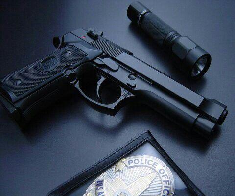 LAPD badge, gun, and flashlight.