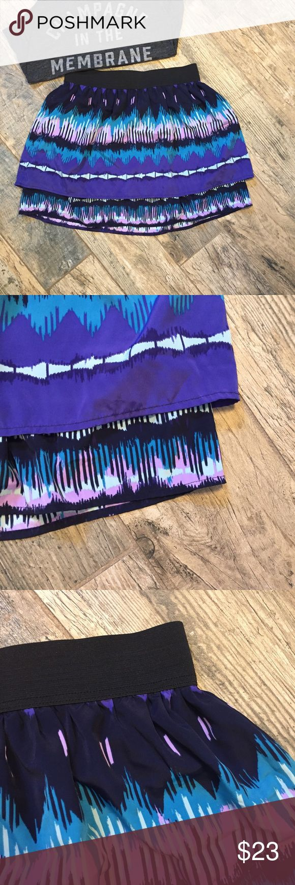 LC Lauren Conrad Tiered Multicolor Miniskirt Sz 10 Sz 10 LC Lauren Conrad Tiered Multicolor Miniskirt. Purple, black, and blue tones in an abstract print. Exposed zipper closure in back, elastic waist. Easy breezy! Approx measurements laid flat = 14 straight across at waist, 16.5 drop from top to bottom. Get ready for spring! LC Lauren Conrad Tiered Multicolor Miniskirt is colorful fun! LC Lauren Conrad Skirts Mini