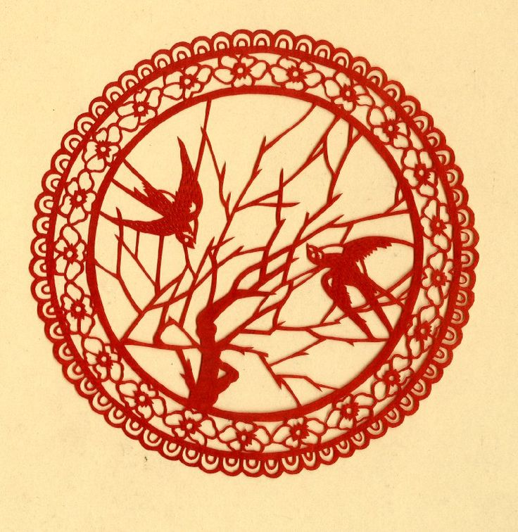 Papercut. Bird. Red on paper.