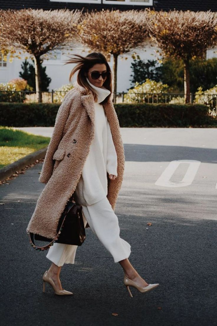 Tan fuzzy teddy bear coat with all white outfit.