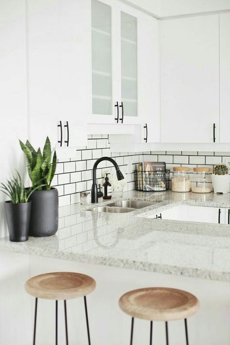 wood stools, subway tile with dark grout & green plants