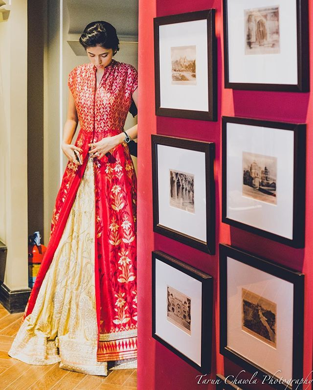 Looking for an alternate Sangeet outfit ? The Banarsi jacket by @anitadongre paired with a Lehenga is what our second red carpet bride @palakagr wore | shot by @tarunchawlaphotography | makeup by @deepti_khaitan | full story on WedMeGood.com  #bride #jacket #jacketlehenga #gold #red #banarsi #anitadongre #sangeet #engagementday #engagement #wedding #weddingday #weddingdress