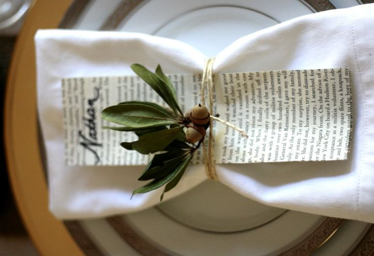 Napkin tied with twine and oak leaf sprig.  Cute idea for book club dinner party.