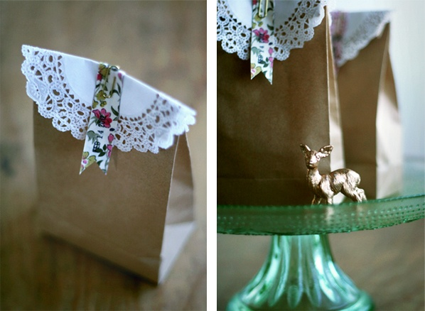 cookies in a brown bag with a doily, floral flag, date stamp and paperclip