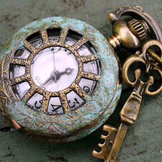 Vintage pocket watch and key