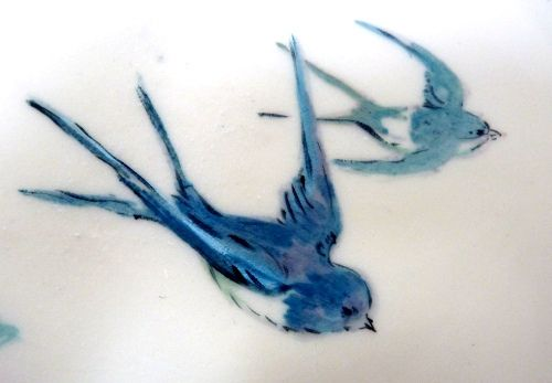 Love this detail of a painted cake with swallows