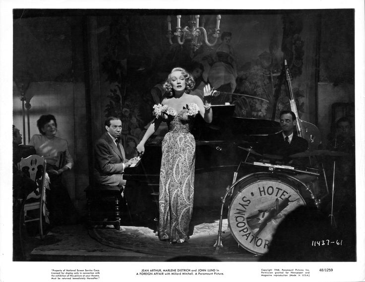 """""""A Foreign Affair"""" (1948) film still, © Paramount Pictures. Courtesy of the Margaret Herrick Library, Academy of Motion Picture Arts and Sciences. Shown: Friedrich Hollaender at piano, Marlene Dietrich."""