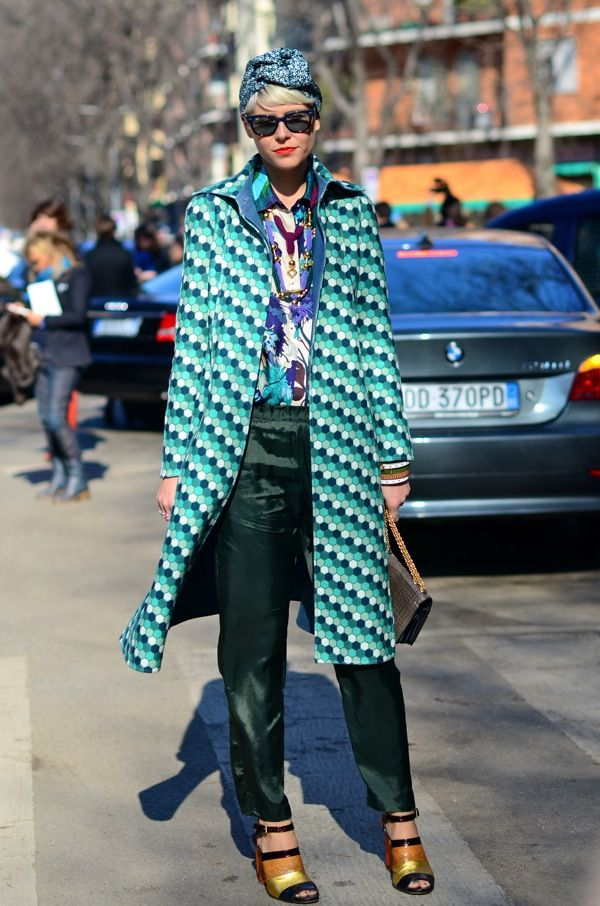 Elisa Nalin in Paris.  Truly inspired outfit.  The patterned shirt ties in the shoes & bag.  The geometry of the shoes works well with that of the coat.  The turban tops it off so well.