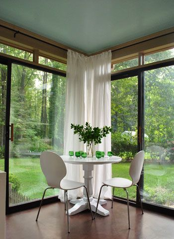 Sunroom Curtains are nicely tucked in the corner when not needed
