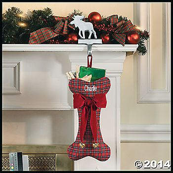 During the hustle and bustle of the Christmas season, don't forget about your pet. Hang our cheery polyester plaid bone Christmas stocking from the mantel ...