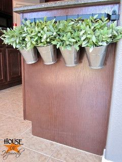 towel rod in the kitchen for herb pots    Use this concept on deck with metal railing.