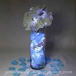 Easy wedding centerpiece idea: LED vine lights with aqua rose petals and silk hydrangeas.