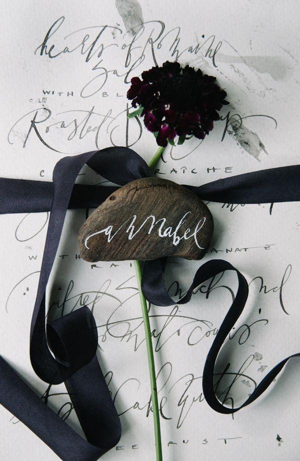 calligraphy rocks - photo by Tulip and Rose Photography http://ruffledblog.com/annabel-lee-wedding-inspiration #namecard #escortcard