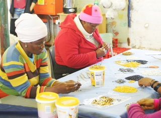 Beading community in NW Province have sustainable employment making The Bead Co's cause-related bracelets. www.beadcaolition.com