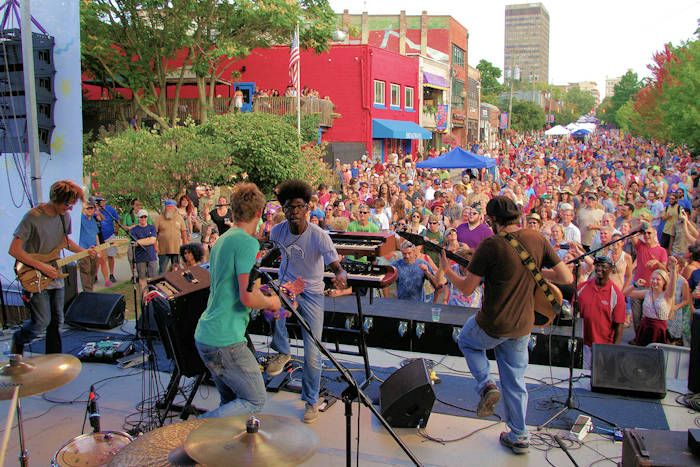 Downtown After Five provides free live outdoor music concerts in downtown Asheville, NC every third Friday, May through September. Thousands gather on North Lexington Avenue near the I-240 overpass, 5-9 PM.