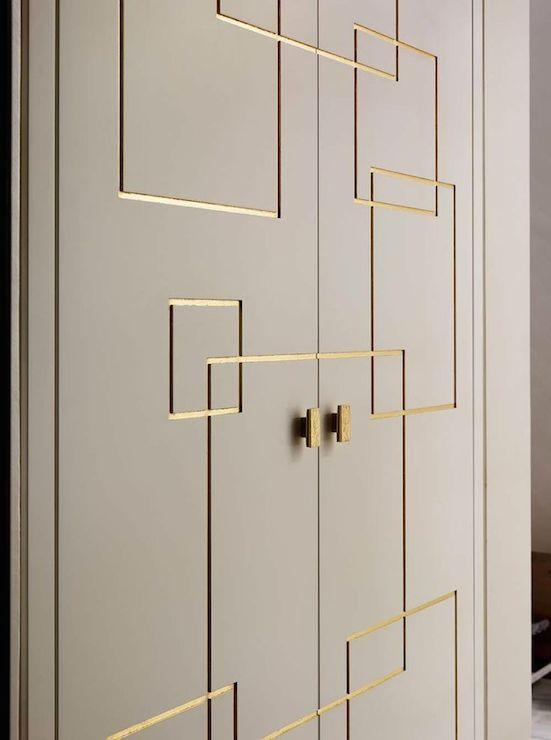 Closet Bi-Fold Doors accented in a gold Greek key design.