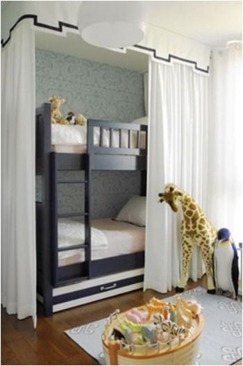 The look that appeals to me most is this one – I love the tailored valance and the floor to ceiling panels – perfect for putting on a show or closing off the beds to tell those spooky stories with flashlights under their chins – I'm thinking this canopy is a doable DIY project. bunk beds surrounded by a valance with ribbon trim, tented bed.
