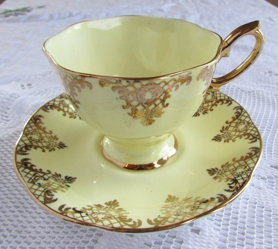 Royal Albert Gold and Cream Tea Cup and Saucer by TheAcreage
