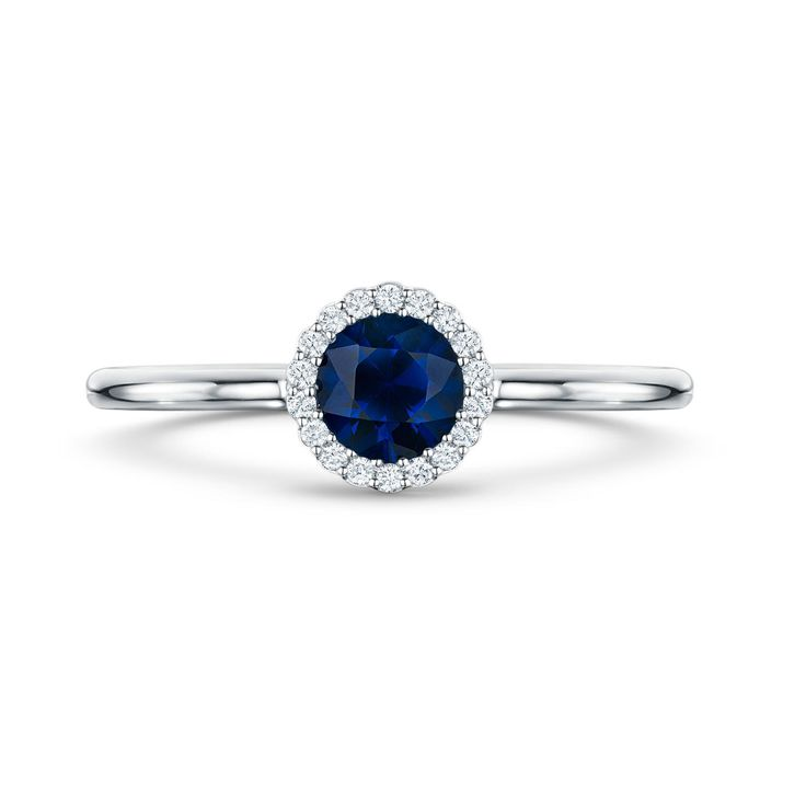 Andrew Geoghegan Cannelé blue sapphire engagement ring in a very classic style with a dark blue colour. Surrounded by diamonds set in white gold. For a traditional bride. http://www.thejewelleryeditor.com/bridal/article/sapphire-engagement-rings-number-one-coloured-gem/ #wedding