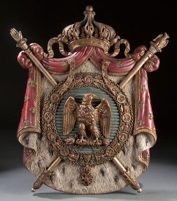 A CARVED POLYCHROME AND GILT WOOD FRENCH COAT OF ARMS, SECOND EMPIRE (1852-1870). Carved in high relief with good detail and proportions and pierced crown finial. Jackson's International Auctioneers and Appraisers