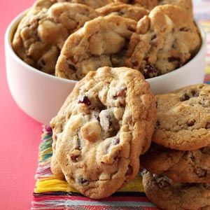 Quick Cranberry Chip Cookies Recipe from Taste of Home - leaving out the pecans and subbing dark chocolate chips for the white. Yummmm