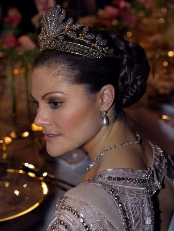 crown princess victoria of sweden wearing a the Cut Steel Tiara and a pearl earrings and a diamond necklace