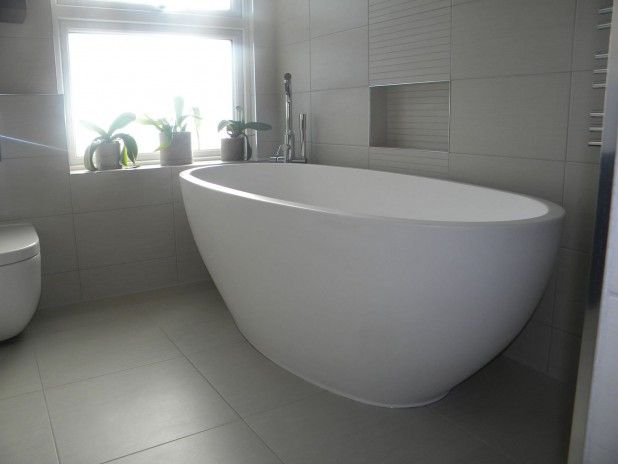 Furniture. 34 Amazing Freestanding Bathtub For Your Bathroom Designs. Minimalist Bathroom Decoration Ideas with Oval Freestanding Bathtub and Chrome Bathtub Filler faucet and White Toilet also Cream Ceramic Tile Floor and Walling plus 3-piece Indoor Green Plant in Pot