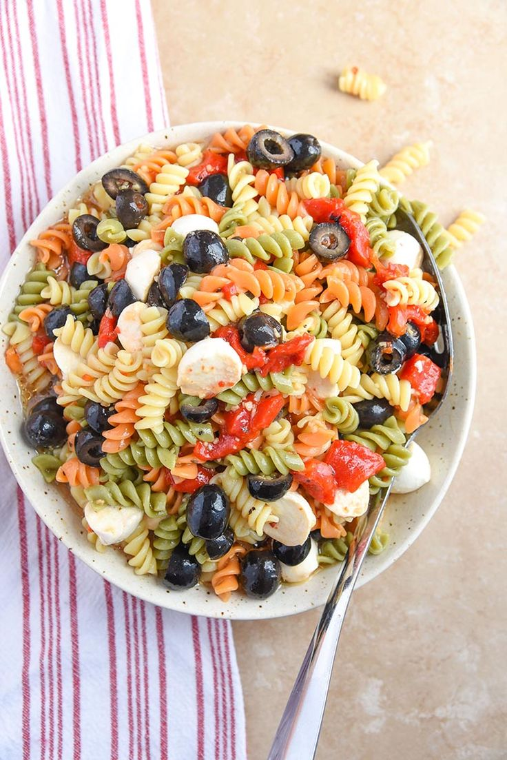 This Tri Colored Pasta Salad Recipe is a quick and easy recipe that is great for picnics and potlucks! We especially love making this tri color pasta recipe