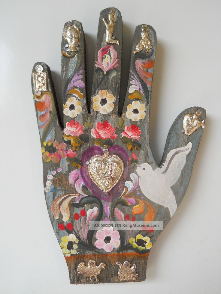 mexican_folk_art_decoration_wood_hand_with_a_heart_and_7_milagros_1_lgw.jpg