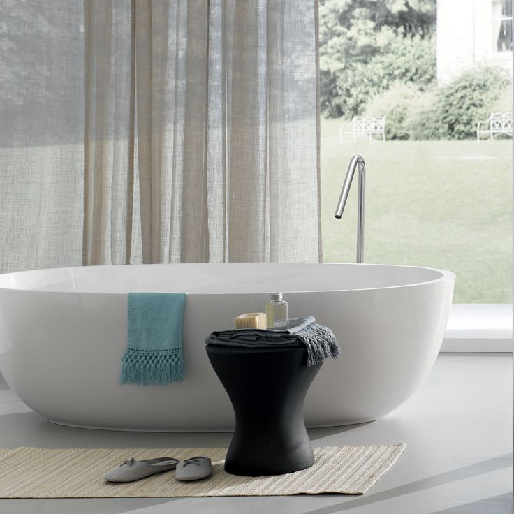 """Designed to deliver a deep-soaking #bathing experience, new halo thin profile transitional #bathtub stands at 67""""x 31 1/2"""", crafted from our signature Eco-friendly #blustone material"""