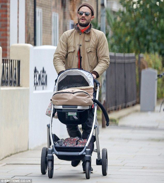 Family time: Doting father Jamie Dornan was on daddy duty on Sunday as he headed out on a stroll with his daughter Dulcie, two, ahead of the arrival of baby number two with wife Amelia Warner