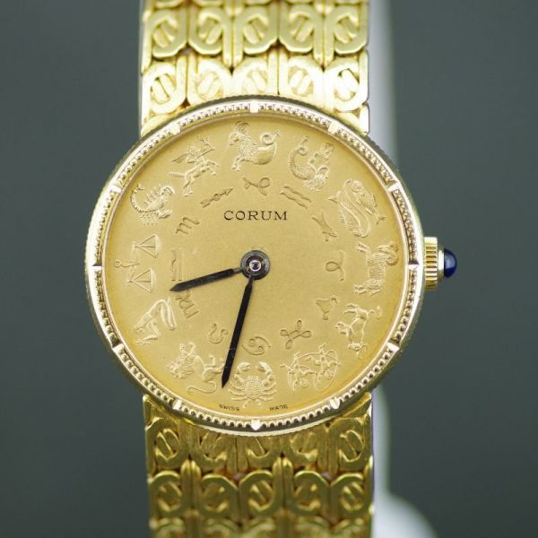 【中古】CORUM(コルム) コイン ホロスコープ 星座 手巻き K18 レディース ゴールド文字盤時計/文字盤に星座が描かれたコルムのコインウオッチです。/新品同様・極美品・美品の中古ブランド時計を格安で提供いたします。