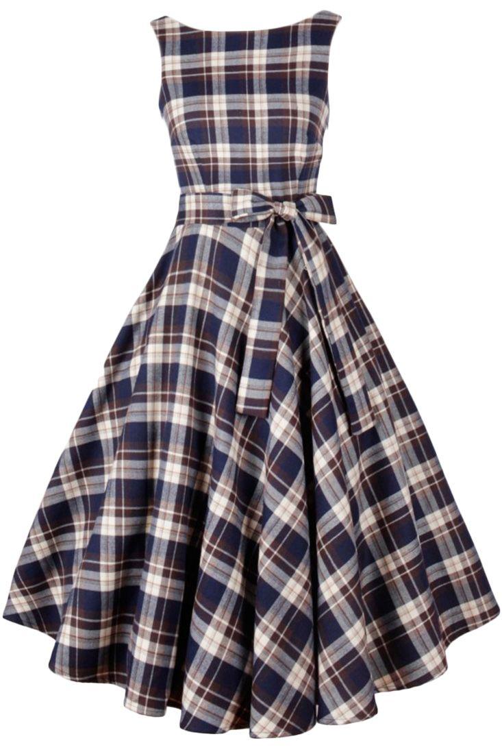 the dress featuring tartan pattern print. sleeveless. belted. side zip fly. v back. swing skirt bottom.