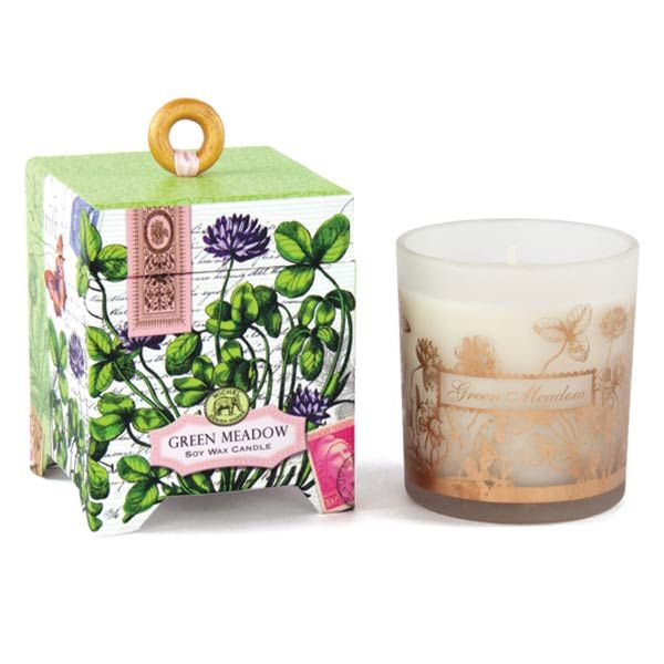 Michel Design Works Candle - Green Meadow — Our handmade, all-natural candles are 100% soy wax, a renewable resource that's nontoxic, biodegradable, and burns clean. Each candle comes in a printed glass container packaged in a footed box with a wooden ring pull.