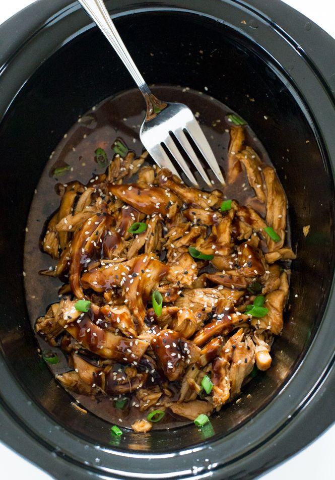 Slow Cooker Honey Garlic Chicken. Slow cooked chicken in a sweet and tangy Asian inspired sauce.