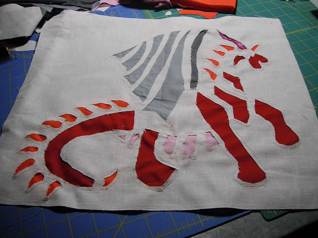 My dragon is born!  This reverse applique dragon is going to become one of the panels of my tote!