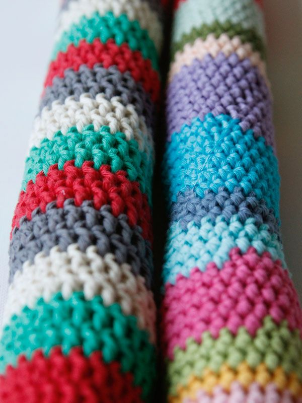 Crocheted draft stoppers. Excellent way to use up scraps!