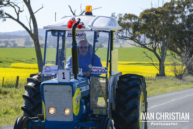 2014 Tractor Trek - Geoff driving his tractor through the canola fields near Cudal - Ivan Christian Photography http://ivanchristianphotography.com/