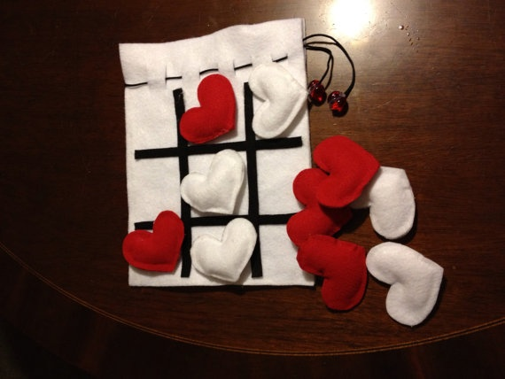 Felt tic tac toe in travel bag.  Seasonal pieces available.