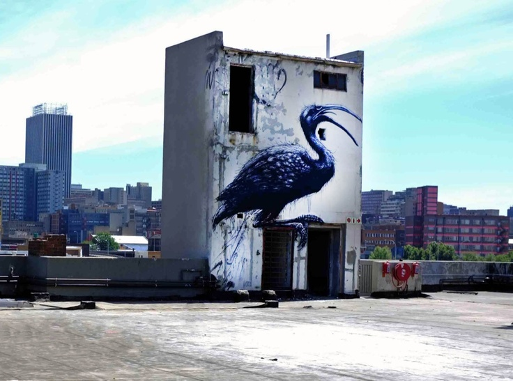Street art on top of Revolution House in the Maboneng Precinct, downtown Johannesburg. By Belgian street artist ROA, photographed by Mr Baggins.