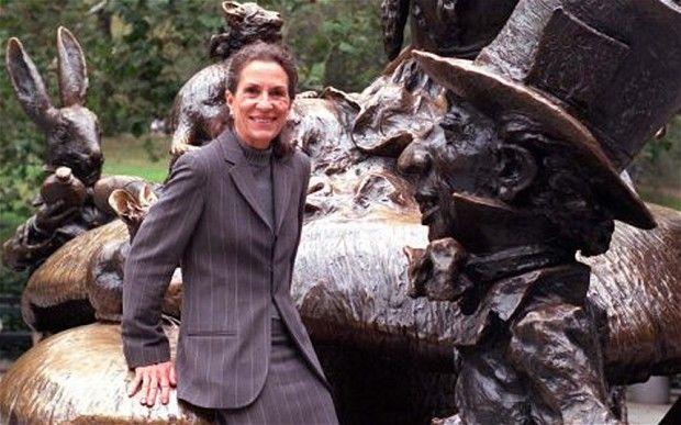 Diane Disney Miller, daughter of entrepreneur Walt Disney, poses beside the Alice In Wonderland sculpture in New York, Central Park, in October 1998