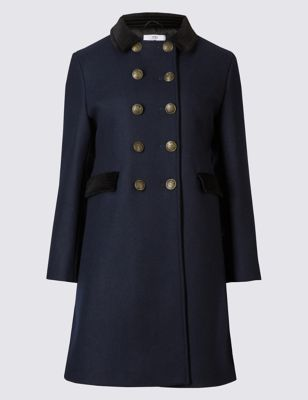 Originally inspired by a 90s children's coat, this piece combines classic tailoring with the military trends from the autumn/winter 16 catwalks. The pleat at the back adds volume and movement while the ¾ sleeves are perfect to show off other layers. The buttons and velvet trim add texture and give a further nod to the original piece. A tailored fit, we recommend going up a size if you're likely to layer.