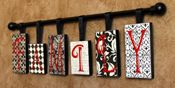 """FAMILY"" I like this! Random sized thin blocks of wood are covered with coordinating papers and then letters are applied. Ribbon loops are added for hanging. Hang blocks from a curtain rod. Simple and fun! But .... make extra letters and now you can swap out your words at anytime!!! Could do last name too!"