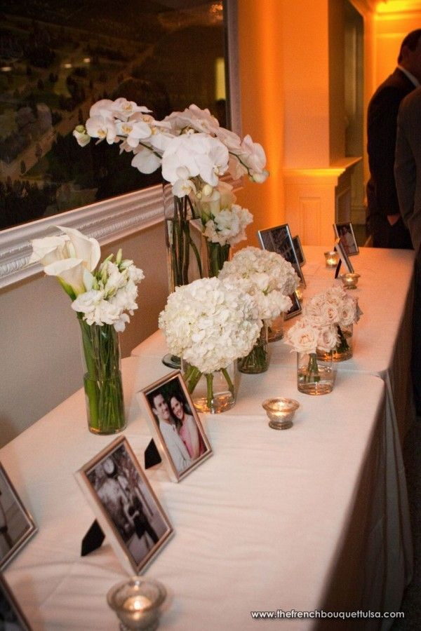 Entry & Photo Table with Floral Arrangements of White Phaelenopsis Orchids, Hydrangea, Calla Lilies, Snap Dragons, Lisianthus and Champagne Sahara Roses