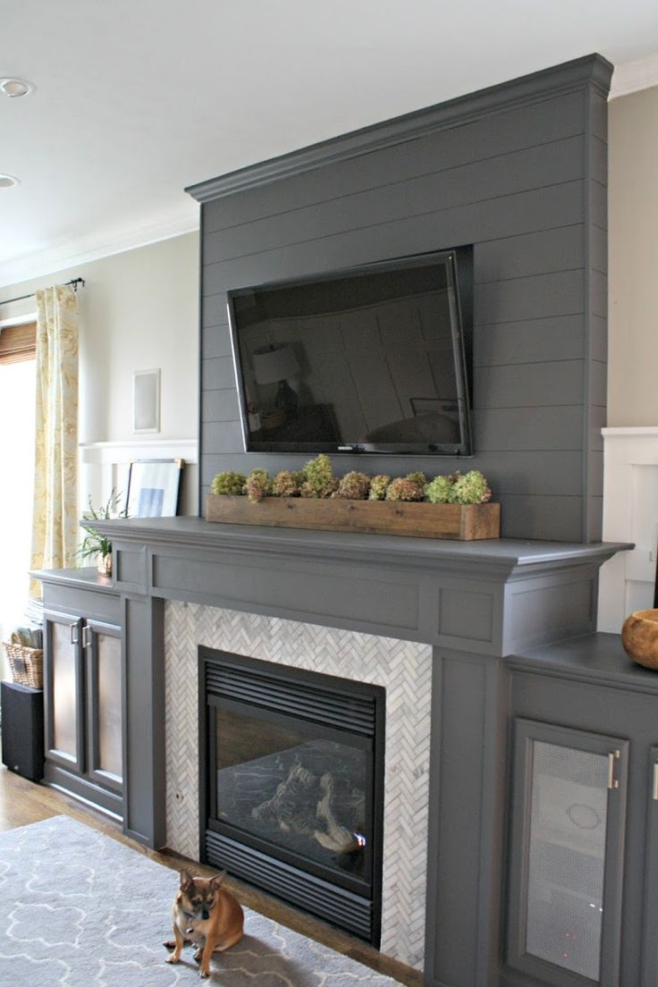 gray fireplace herringbone tile
